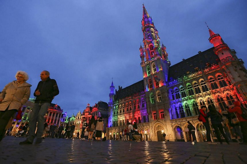 The City Hall and Grand Place of Brussels is illuminated in rainbow colours for the mass shooting victims at the Pulse nightclub in Brussels, Belgium.
