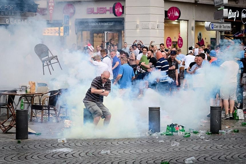 England supporters engulfed in tear gas during clashes with police in Marseille, southern France on June 10, the eve of England's Euro 2016 football match against Russia.