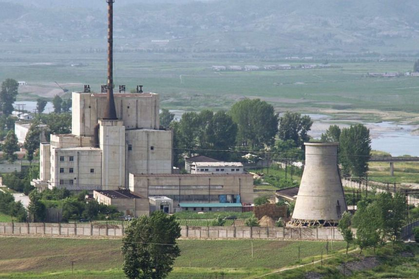 A North Korean nuclear plant is seen before demolishing a cooling tower (right) in Yongbyon, in this photo taken June 27, 2008, and released by Kyodo.