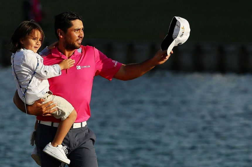 Jason Day of Australia celebrates with son Dash after winning during the final round of THE PLAYERS Championship at the Stadium course at TPC Sawgrass on May 15, 2016 in Ponte Vedra Beach, Florida.
