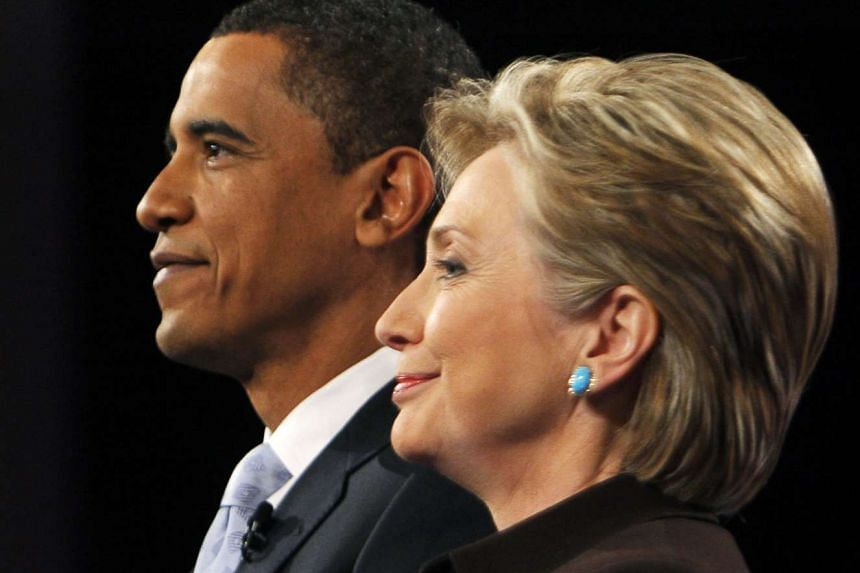 Former US Democratic presidential candidates Senator Barack Obama (D-IL) and Senator Hillary Clinton (D-NY) pose for photographers prior to the CNN/Los Angeles Times Democratic presidential debate in Hollywood, California on Jan 31, 2008.