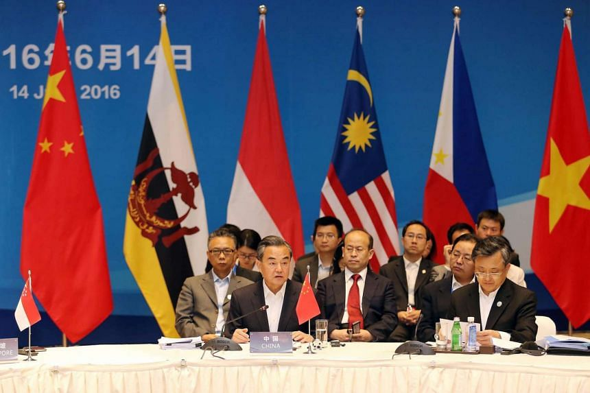 China's Foreign Minister Wang Yi (centre) speaks during the Special Asean-China Foreign Ministers' Meeting in Yuxi, Yunnan Province, China on June 14, 2016.