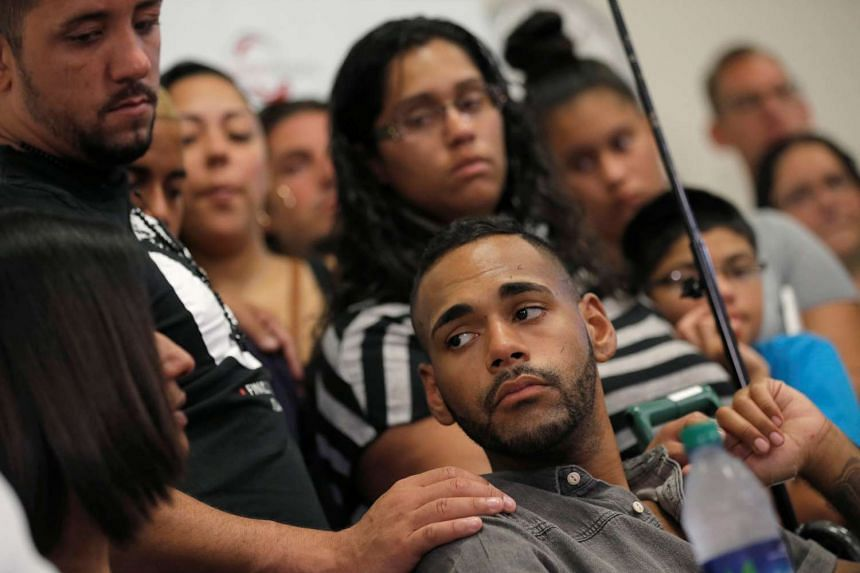 Gunshot survivor Angel Colon is surrounded by family as he listens to remarks at a news conference at the Orlando Regional Medical Center on the shooting at the Pulse gay nightclub in Orlando, Florida, on June 14, 2016.