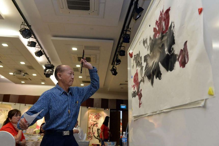 Mr Tan Khim Ser, Founder and President of Life Arts Society, demonstrates the art of Chinese painting during the media launch.