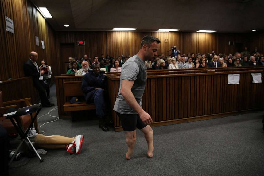 Paralympic gold medalist Oscar Pistorius prepares to walk across the courtroom without his prosthetic legs during the third day of his hearing in Pretoria, South Africa, on June 15, 2016.