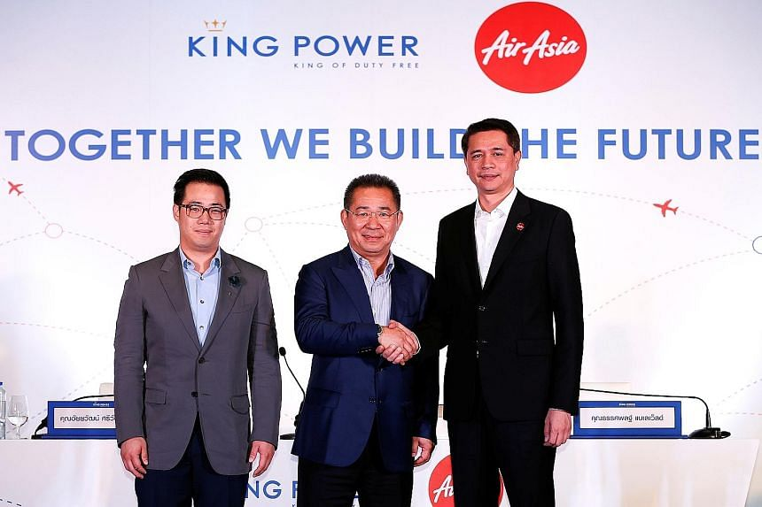Mr Vichai, King Power's chairman (centre), with Mr Bijleveld, Thai Air Asia's CEO (right), and Mr Aiyawatt, King Power's CEO, at the signing of the deal yesterday.