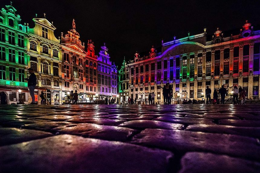 The heritage buildings of the Brussels Grand Place lit up in the colours of the LGBT rainbow flag on Monday to honour the victims of the mass shooting at a gay nightclub in Orlando, Florida, on Sunday.