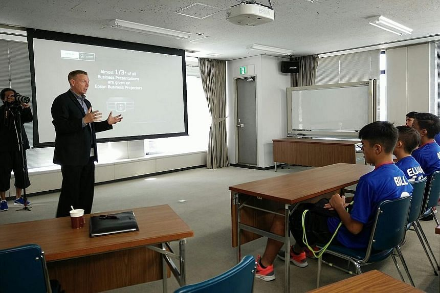 Ian Cameron, general manager of Epson (global brand and communications), speaking to several Singapore youth players who are training in Japan with Matsumoto Yamaga under the company's global sponsorship.