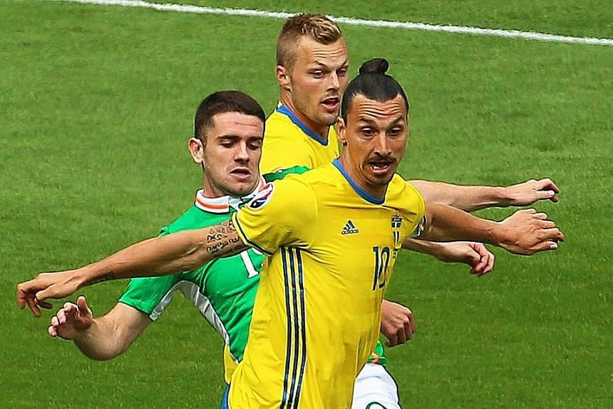 Sweden's Zlatan Ibrahimovic (front) in action against Ireland's Robbie Brady (left). The Paris St Germain hero cut an anonymous figure as his side failed to manage a single shot on target.