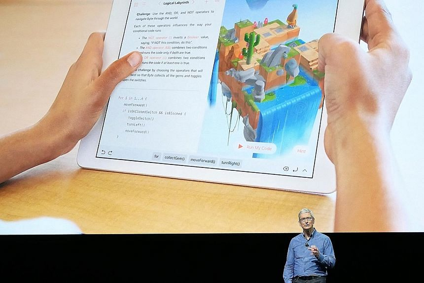 Apple's chief executive Tim Cook announcing Swift Playgrounds at the firm's Worldwide Developer Conference. Users of the app will be asked to write codes for an animated character to perform simple tasks.