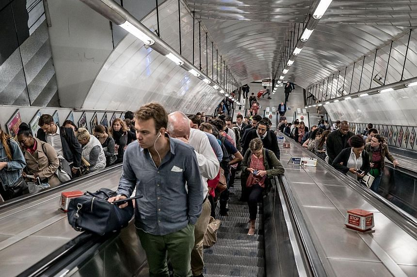 The evening rush hour last Thursday at the busy Holborn station. During peak periods, the station ditches the convention of leaving one side of the escalator clear for people to walk up.
