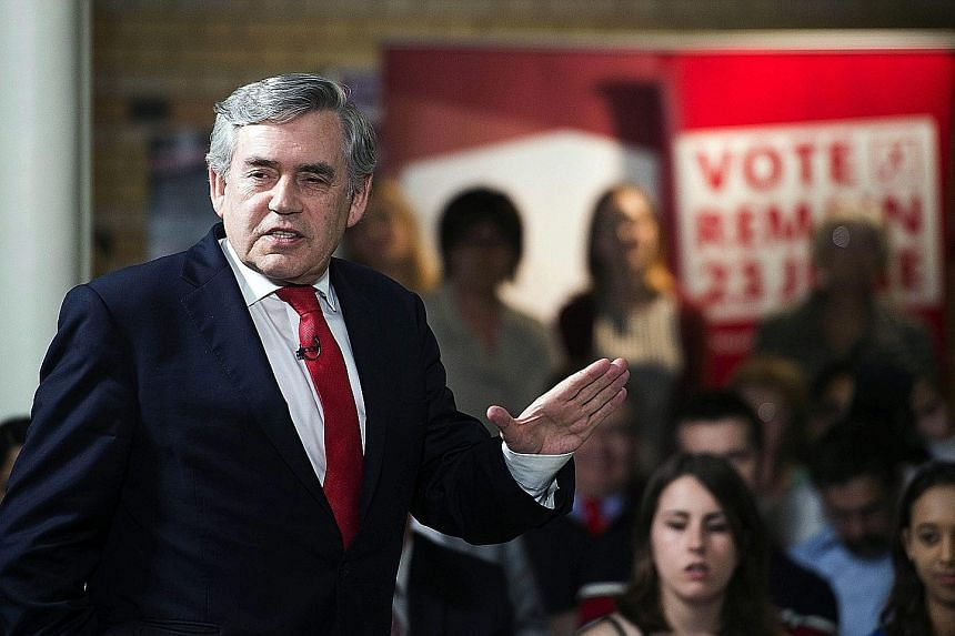 Top: An advertisement in Vauxhall, London, campaigning for Britain to leave the European Union. Above: Former prime minister Gordon Brown at a 'Remain'' event in Leicester on Monday. He made an impassioned plea to Labour voters not to turn their back