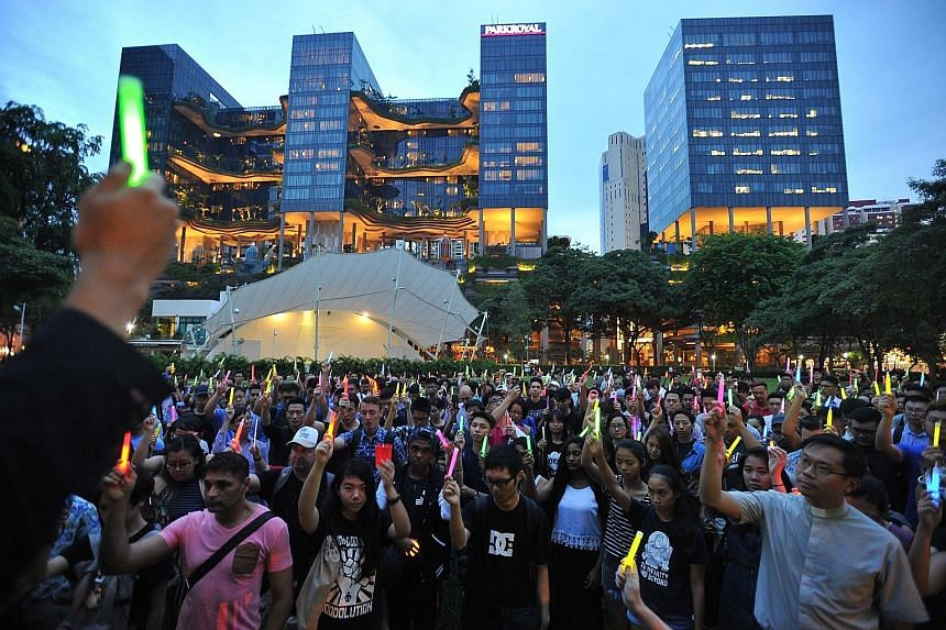 More than 700 people joined a candlelight vigil at Hong Lim Park last night following the Orlando gay club shooting. Members of Singapore's LGBT community said they do not rule out the possibility of violence taking place here and called for a dialog