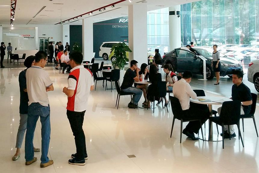 The crowd at a Toyota showroom on May 27.