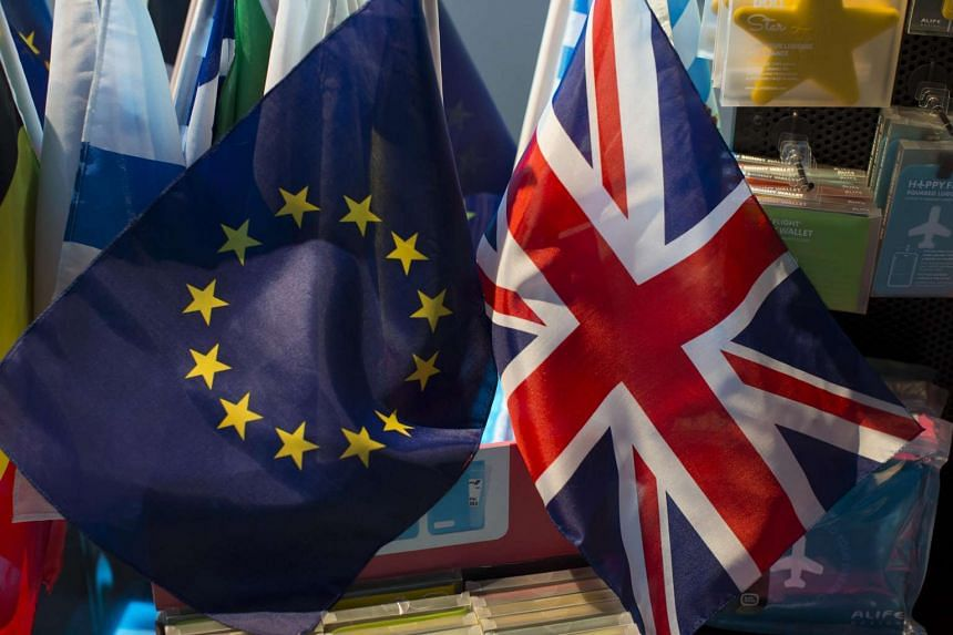 The British (right) and European Union flags displayed at a gift shop at the European Parliament in Brussels.