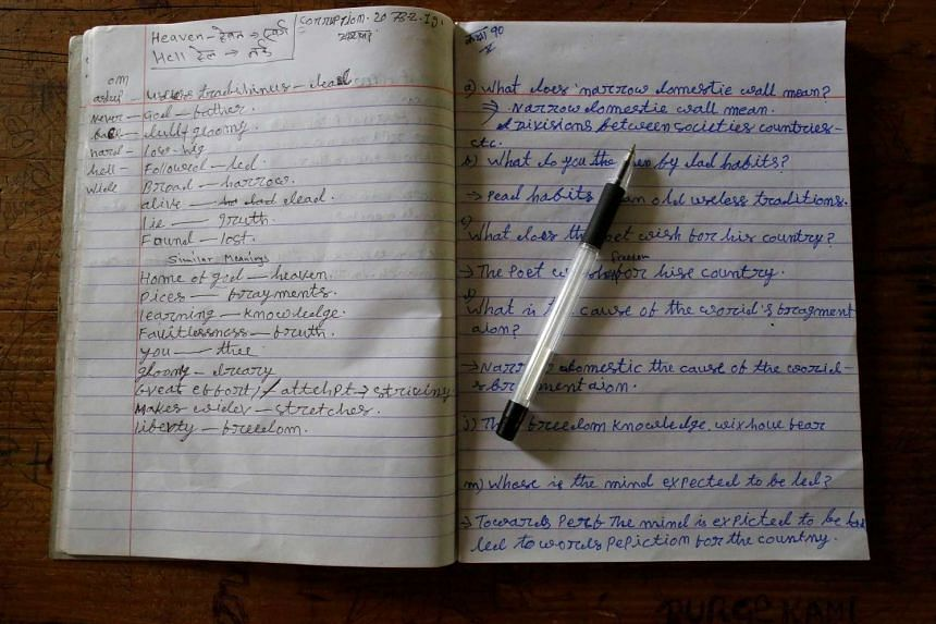 An English notebook belonging to Durga Kami, 68, who is studying in the tenth grade at Shree Kala Bhairab Higher Secondary School, is seen on his desk in Syangja, Nepal, on June 6, 2016.