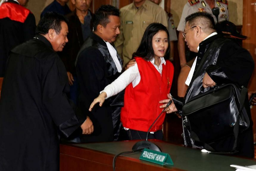 Indonesian Jessica Kumala Wongso (centre) talks with her lawyers after her trial at the Central Jakarta Court, Jakarta, Indonesia on June 15, 2016.