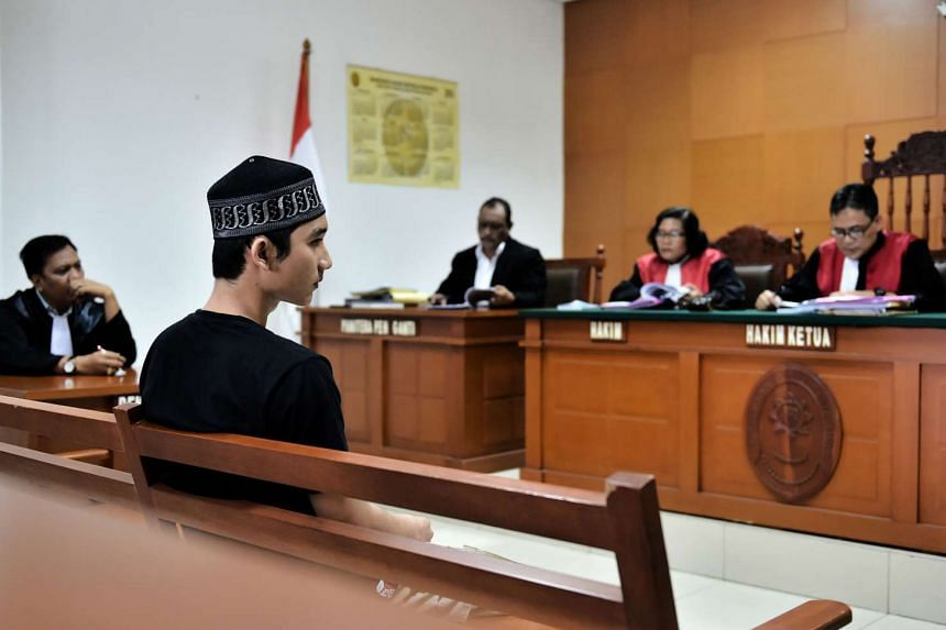 Suspected terrorist Ibadurrahman (second from left) listens to the judges read out their verdict during his trial in Jakarta on June 15, 2016.