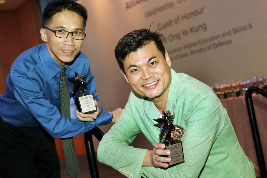(From left) Mr Tay Chiew Teck and Mr Alvin Yapp, recipients of the Platinum Award at the Singapore Children's Society's Awards Presentation ceremony.