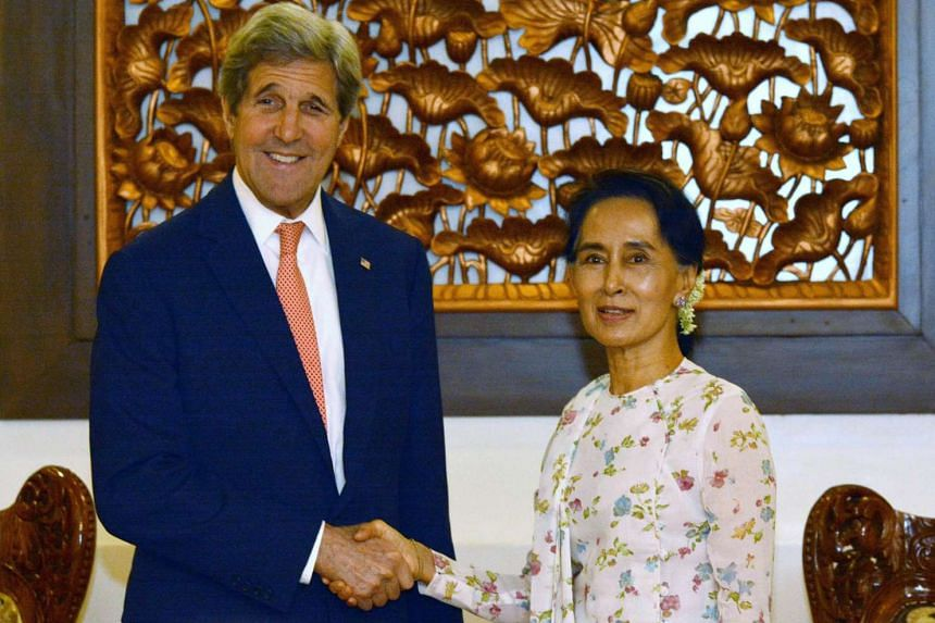 US Secretary of State John Kerry shaking hands with Myanmar's Foreign Minister Aung San Suu Kyi during a meeting in Naypyitaw on May 22.