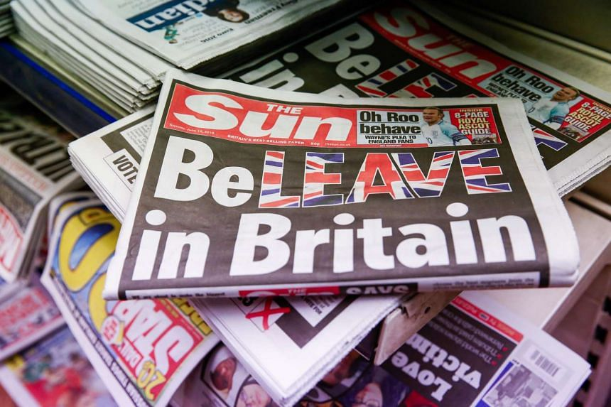Copies of The Sun newspaper sit on a newsstand in this arranged photograph in London on June 14, 2016.