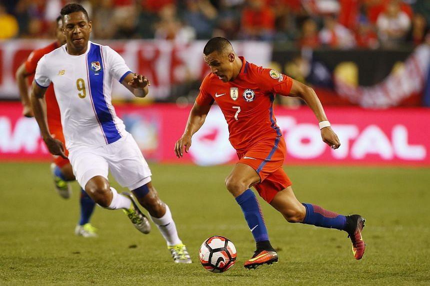 Chile's Alexis Sanchez moving with the ball as Panama's Roberto Nurse defends.