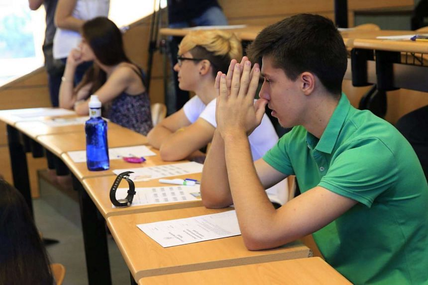 Students waiting for the start of University access exams at the Complutense campus in Madrid.