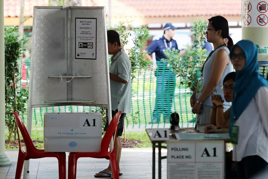 Voters at the polling station at Bukit Batok Secondary School on May 7.