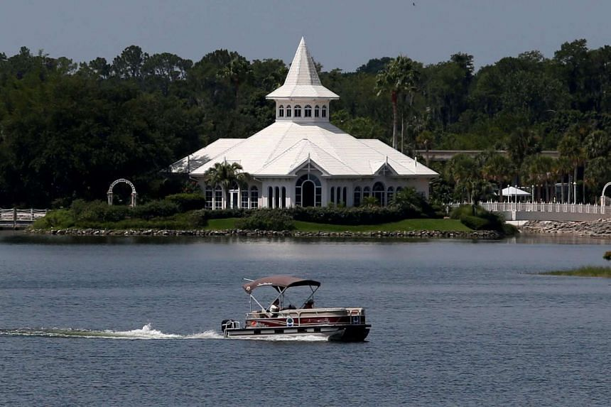 A search boat passes Disney's Fairy Tale Weddings Chapel, located near the Grand Floridian, as police hunted for the child on June 15, 2016.