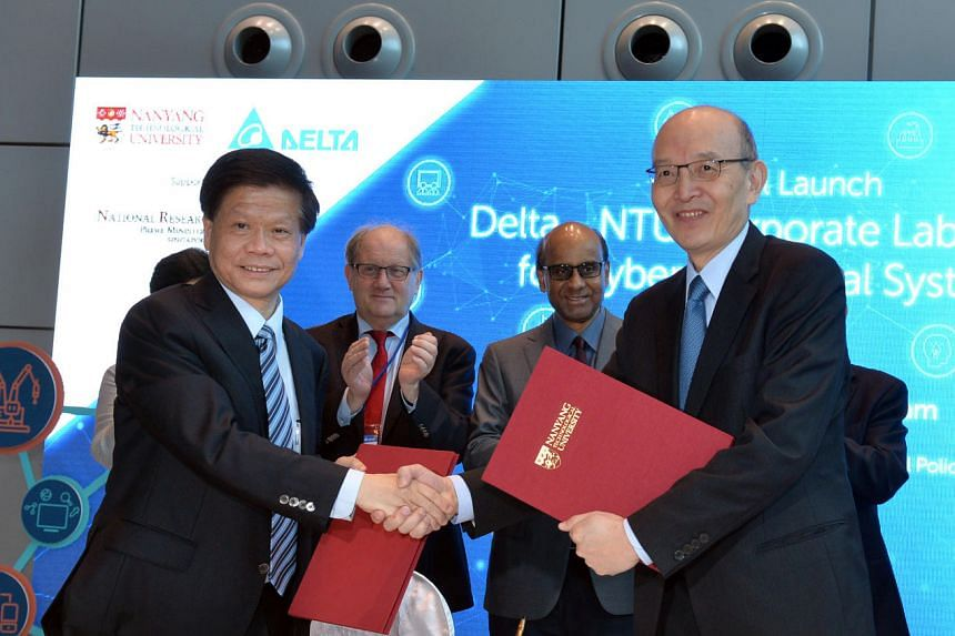 Signing the  memorandum of understanding were NTU's Chief of Staff and Vice President ( Research ) Prof Lam Khin Yong (left) and Chief Technology Officer of Delta Electronics Dr Thomas Li.