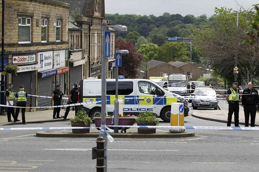 Police stand behind a cordon in Birstall near Leeds, on June 16, 2016.