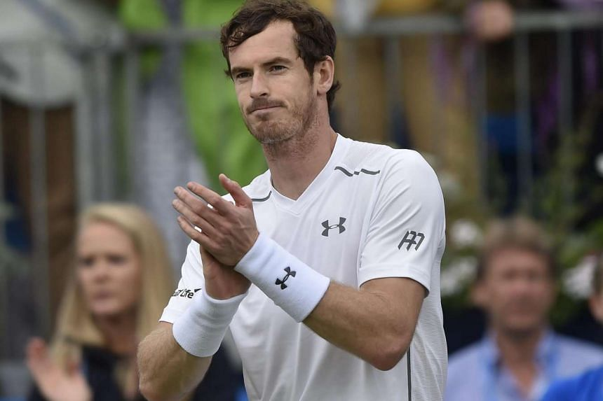 Andy Murray celebrates after winning his second round match against Aljaz Bedene at the Aegon Tennis Championships in London, on June 16, 2016.