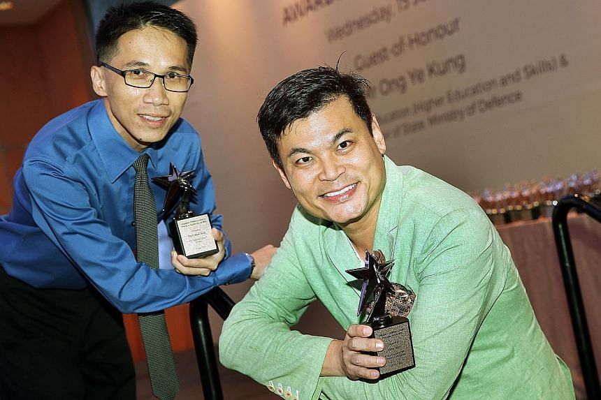 At the Singapore Children's Society's Awards Presentation ceremony yesterday, Mr Tay (left) received the Platinum Service Award, given to those who have served for at least 15 years. Mr Yapp received the Platinum Award, given to those who raise betwe