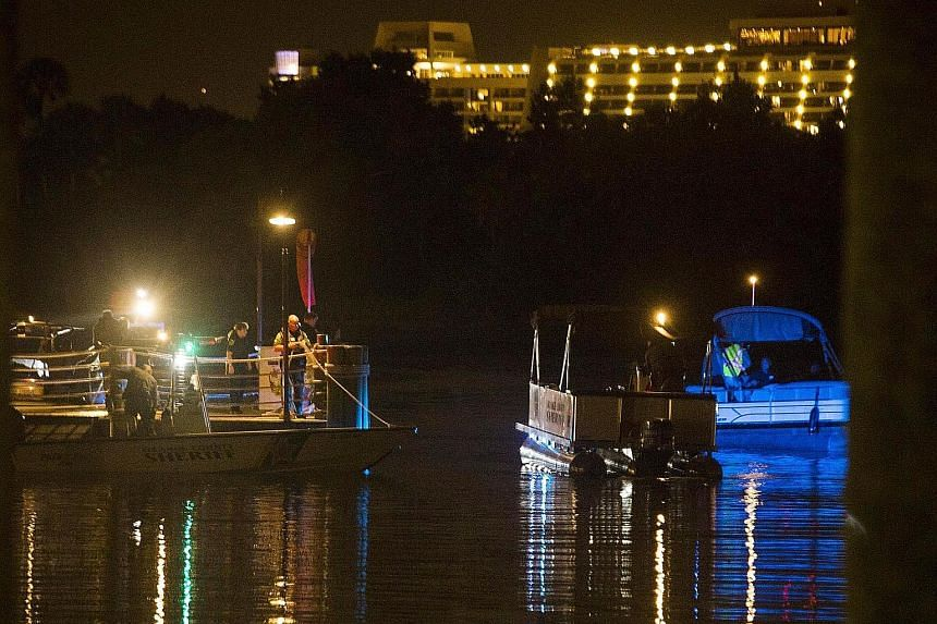 Police officers searching for the two-year-old who was pulled into the water by an alligator at a lake in Disney's Grand Floridian Resort and Spa in Florida. The authorities say the boy is unlikely to be found alive.