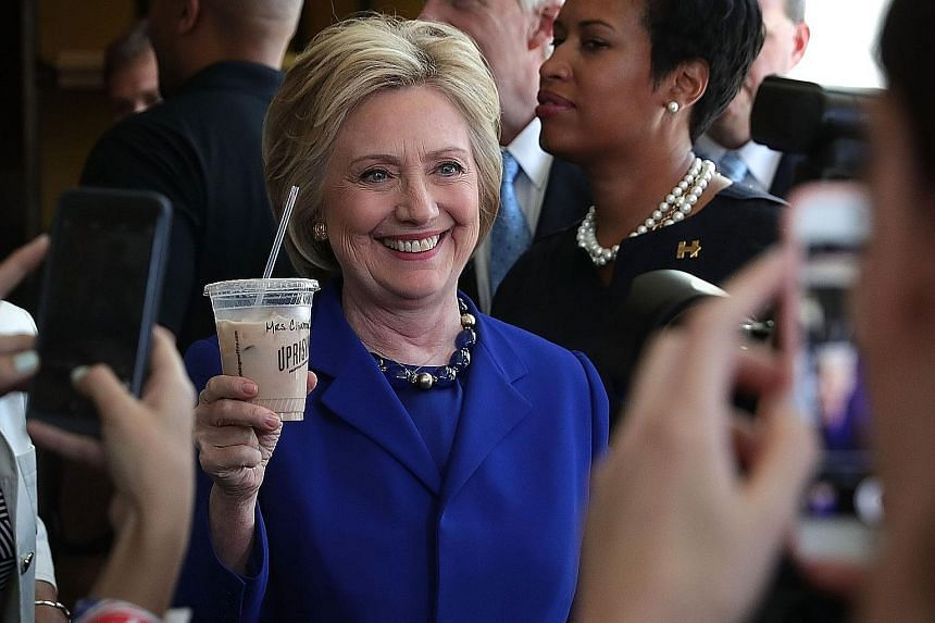 Mrs Hillary Clinton on the campaign trail last week. She is now projected to have about 400 more pledged delegates and four million more votes than her rival Bernie Sanders.
