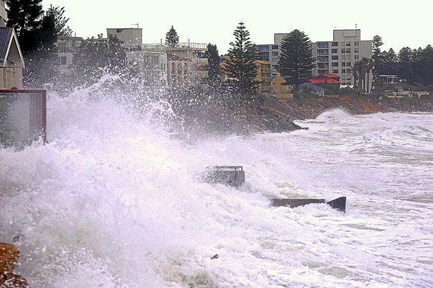 Waves smashing against properties in the northern Sydney suburb of Collaroy during the recent heavy storms that caused several deaths and more than $40 million in damage.