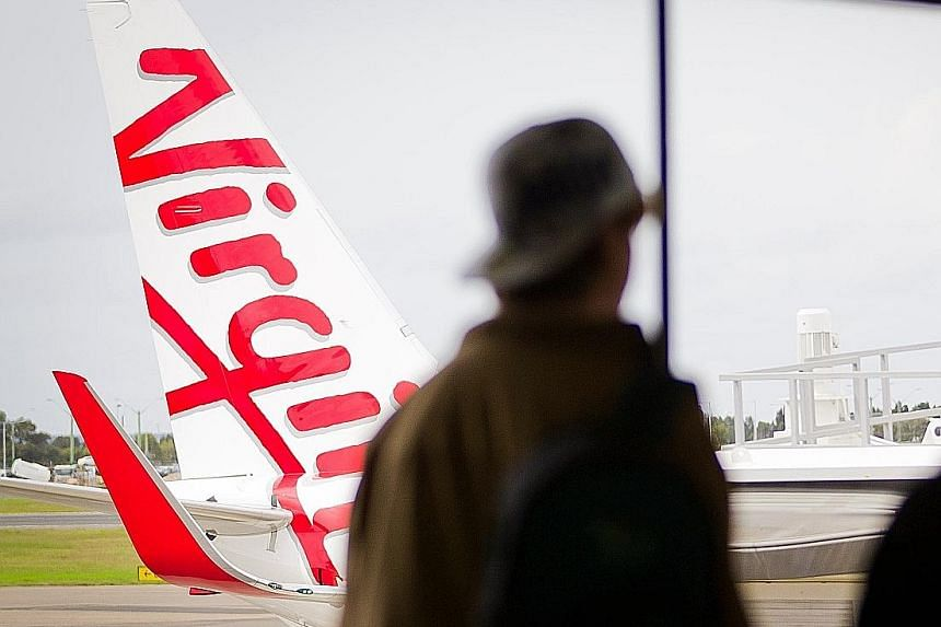 A Virgin Australia aircraft parked at Sydney airport. The carrier is offering existing investors one share for every one they already hold at 21 Australian cents.