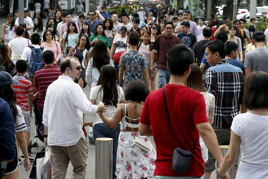 People cross a road in Orchard Road on March 20.