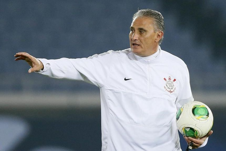 A file picture take in 2012 shows Tite gives directions to players during an official training session ahead of the FIFA Club World Cup 2012 final at Yokohama International Stadium in Yokohama, Japan.