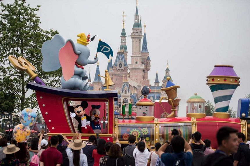 People watch the Mickey Parade at Shanghai Disney Resort in Shanghai on June 15.