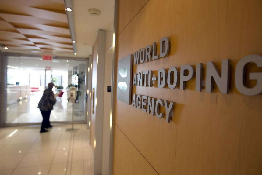 A woman walks into the head office for the World Anti-Doping Agency in Montreal, Quebec, Canada in 2015.