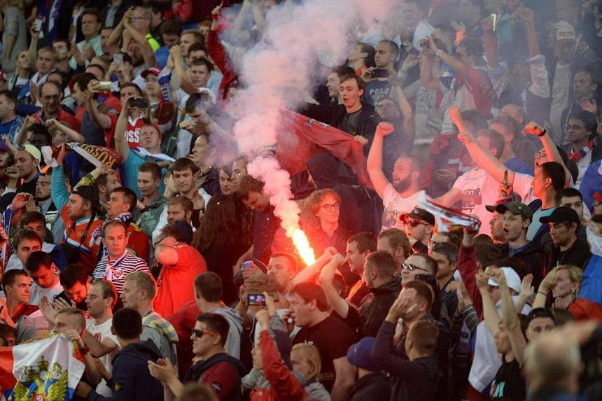 A Russian fan holding a flare during the Euro 2016 match against Slovakia on June 15.