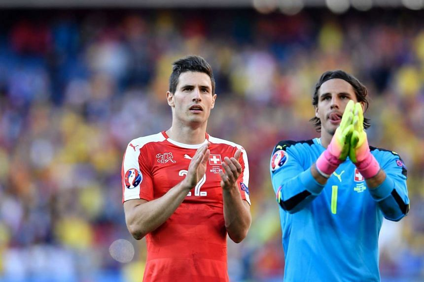Switzerland goalkeeper Yann Sommer and defender Fabian Schaer acknowledge the fans after the 1-1 draw.