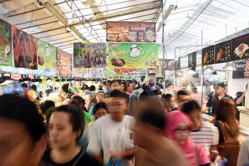People at the Hari Raya bazaar at Geylang Serai on June 12, 2016.