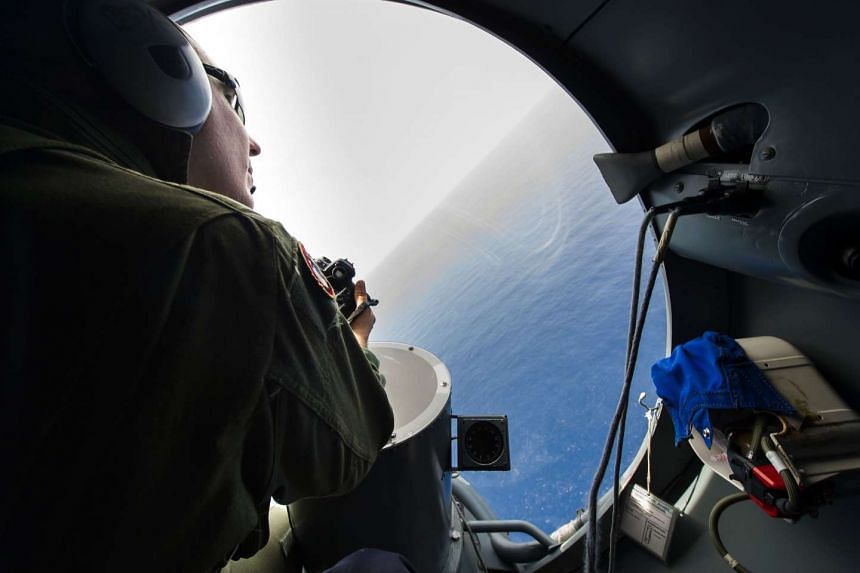 A French soldier aboard an aircraft looks out a window during searches for debris from the crashed EgyptAir flight MS804 over the Mediterranean Sea, on May 22, 2016.