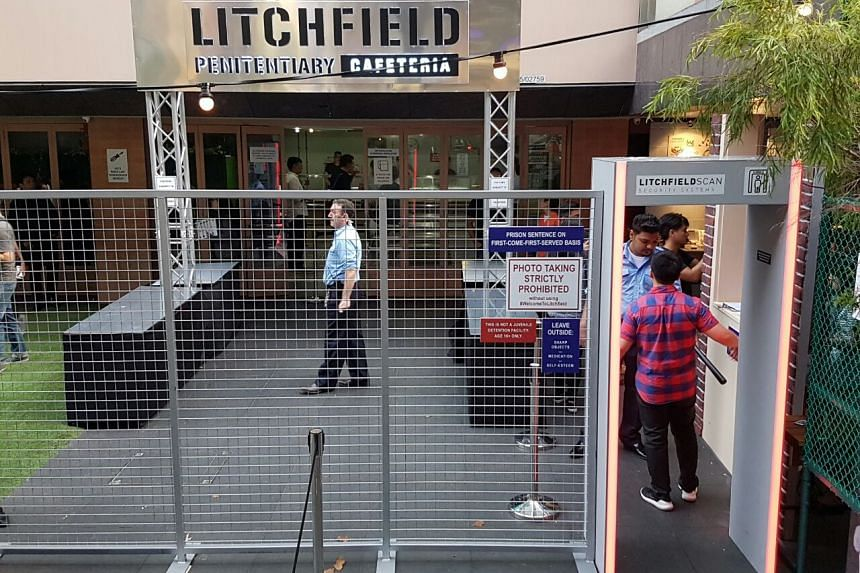 The exterior of the Litchfield Penitentiary Cafeteria experience, a pop-up event that allows patrons to eat grub in a jail-like cafeteria.