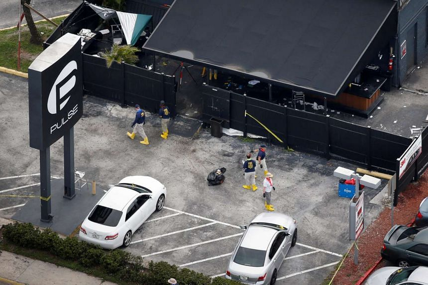 FBI officials collect evidence from the parking lot of the Pulse gay nightclub, the site of a mass shooting days earlier, in Orlando, Florida, US, on June 15.