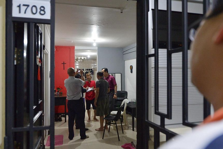 MOH officials and grassroots leaders visit a resident at Block 203 Ang Mo Kio Avenue 3, where six individuals across four unrelated units were detected to have Multi-Drug Resistant Tuberculosis.