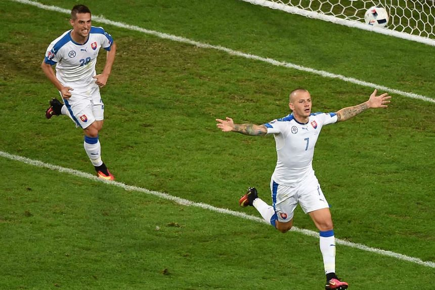 Vladimir Weiss (right) celebrating with Robert Mak after Slovakia scored to take the lead against Russia. His goal preceded Marek Hamsik's strike to give the Slovaks a 2-1 win and revived their hopes of qualifying for the knockout stages after their openi