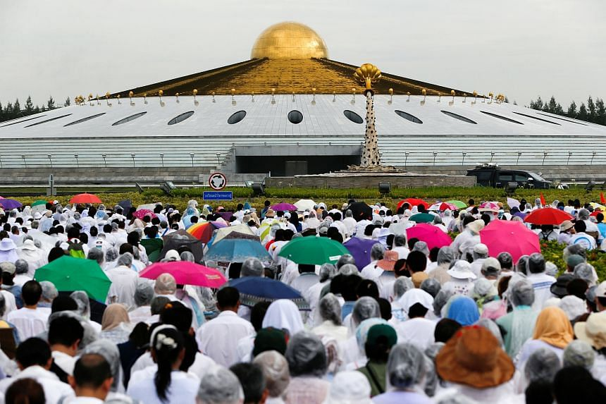 Followers gather inside the Wat Phra Dhammakaya temple complex in anticipation of a planned police raid, in Pathum Thani province, north of Bangkok, Thailand, on June 16.